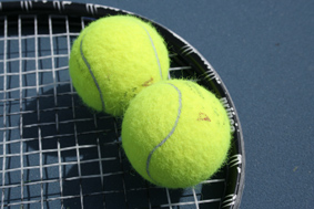 Tennis balls on racquet